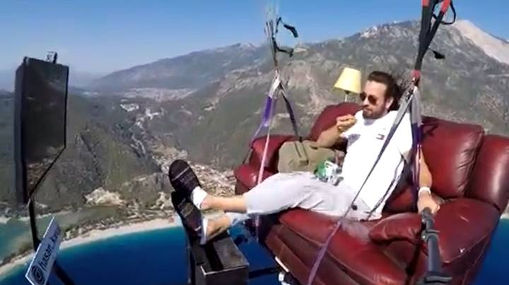 Paragliding Instructor Takes To The Skies On A Couch