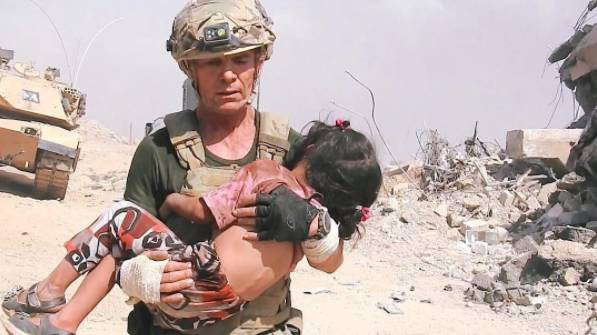 Camera Captures Incredible Moment Man Saves Girl While Under Fire From ISIS