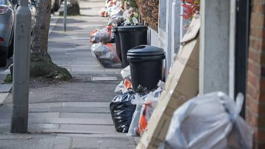 Bins On Streets Filled With Food Waste As People Stockpile More Food Than They Can Eat