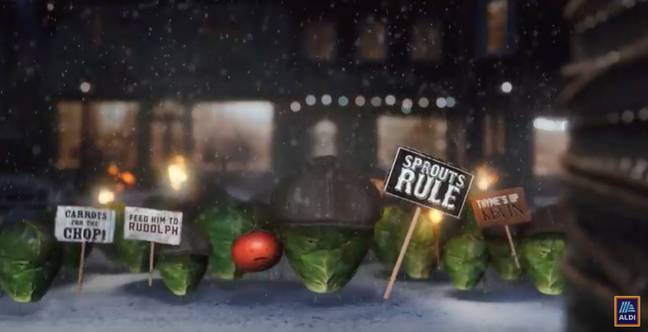 The Leafy Blinders have taken Kevin the Carrot hostage at the start of the advert. (Credit: Aldi)