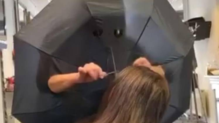Hairdresser Cuts Holes In Umbrella To Create Barrier Between Clients
